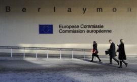 This photo taken on February 8, 2011 shows people walking in front of the European Union Commission building at the EU Headquarters in Brussels. AFP PHOTO / JOHN THYS (Photo credit should read JOHN THYS/AFP/Getty Images)